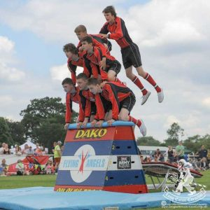 A pyramid of gymnasts on a vaulting box.